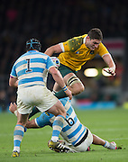 Twickenham. Great Britain,  Rob SIMMONSgoing over the top of Pablo MATERA, during, Semi Final. Australia vs Argentina  2015 Rugby World Cup,  Venue, Twickenham Stadium, Surrey England.   Sunday  25/10/2015   [Mandatory Credit; Peter Spurrier/Intersport-images]