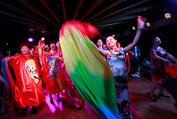 Parents of Chinese LGBTs (lesbian, gay, bisexual and transgender) and volunteers of the Parents and Friends of Lesbians and Gays (PFLAG) China organisation dance with rainbow scarves and colourful costumes during a closing ceremony for the 10th National PFLAG conference held on a cruise in open seas on route back to Shanghai China, 17 June 2017.