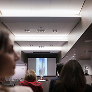 March 14, 2018 - New York, NY : The century-old Equitable Building, whose construction atop an entire city block at 120 Broadway in Lower Manhattan inspired the establishment of zoning regulations, has been undergoing a series of changes including the recent creation of a public hearing room for the Department of City Planning. Further renovation by the building's owner, Silverstein Properties, to be carried out by the architecture firm Beyer Blinder Belle and the landscape architecture firm MPFP, are also underway. Here, a hearing is underway at the Department of City Planning on Wednesday morning, March 14.  CREDIT: Karsten Moran for The New York Times
