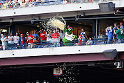 PHILADELPHIA, PA - JUNE 3: Philadelphia Phillies mascot Phillie Phanatic throws a large bag of popcorn over the balcony in the upper deck during the game against the Miami Marlins at Citizens Bank Park on June 3, 2012 in Philadelphia, Pennsylvania. The Marlins won 5-1. (Photo by Joe Robbins)