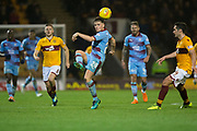 3rd November 2018, Fir Park, Motherwell, Scotland; Ladbrokes Premiership football, Motherwell versus Dundee; Lewis Spence of Dundee clears from Allan Campbell and Carl McHugh of Motherwell