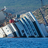 ISOLA DEL GIGLIO, ITALY - SEPTEMBER 14:  The stern of the wreckage of the Costa Concordia is seen on September 13, 2013 in Isola del Giglio, Italy. The Costa Concordia is reportedly due to be righted beginning on the morning of September 16, then, if the operation is successful, it will be towed away and scrapped.  (Photo by Marco Secchi/Getty Images)