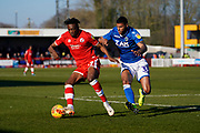 Matt Willock of Crawley Town under pressure from Zak Jules of Macclesfield Town during the EFL Sky Bet League 2 match between Crawley Town and Macclesfield Town at The People's Pension Stadium, Crawley, England on 23 February 2019.