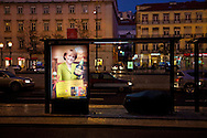"In a bus stop where a beggar is sleeping, a Portuguese company advertises its liquor brand using digital composed images of German Chancellor Angela Merkel and French President Nicolas Sarcozy holding a Licor Beirão bottle, it can be read in the muppie among other things, ""Dear Angela. Portugal is giving its best. Happy Holidays."" , in Lisbon, Portugal. 27/12/2011 IN SALES IN PORTUGAL"