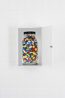 Jar of pills in bathroom cabinet