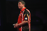 Mensur Suljovic looking dejected as he heads out the tournament during the PDC World Darts Championship at Alexandra Palace, London, United Kingdom on 28 December 2017. Photo by Shane Healey.