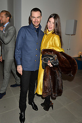 ROBERT SHEFFIELD and LILY LEWIS at the Future Contemporaries Party in association with Coach at The Serpentine Sackler Gallery, West Carriage Drive, Kensington Gardens, London on 21st February 2015.