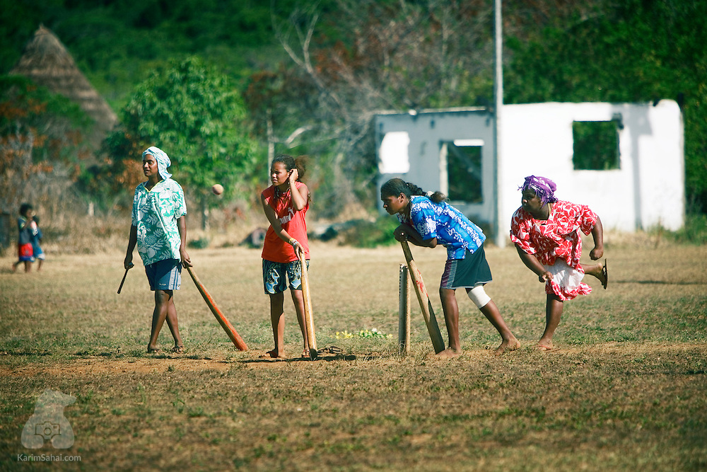 A group of women play a game of cricket on a field near Xepenehe, Lifou island, New Caledonia. The game was introduced by missionaries in the 1800s and enjoys a wide popularity among kanak women. Regional and inter-island championships are held regularly.