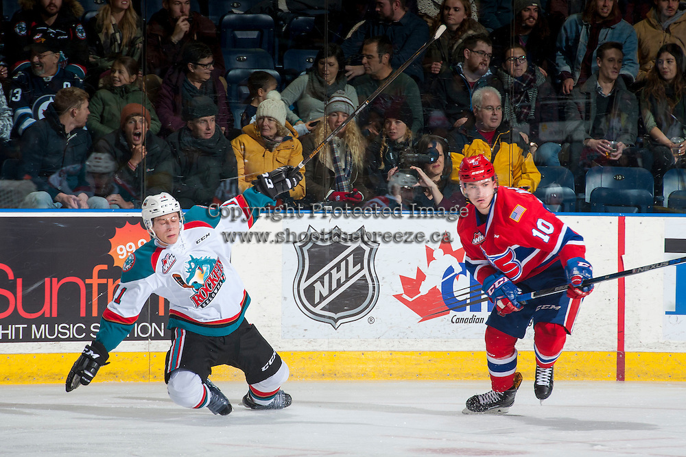 KELOWNA, CANADA - JANUARY 4: Ethan McIndoe #10 of the Spokane Chiefs checks Jordan Borstmayer #11 of the Kelowna Rockets to the ice during first period on January 4, 2017 at Prospera Place in Kelowna, British Columbia, Canada.  (Photo by Marissa Baecker/Shoot the Breeze)  *** Local Caption ***