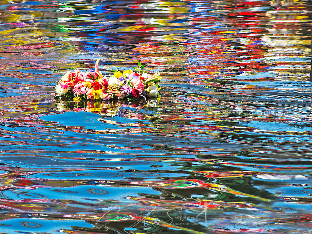 A ceremonial wreath floats in the bayou during the 66th annual Blessing of the Fleet in Bayou La Batre, Alabama, May 3, 2015. A wreath is thrown into the water each year to remember those who have lost their lives while working on the water. The first fleet blessing was held by St. Margaret's Catholic Church in 1949, carrying on a long European tradition of asking God's favor for a bountiful seafood harvest and protection from the perils of the sea. The highlight of the event is a blessing of the boats by the local Catholic archbishop and the tossing of a ceremonial wreath in memory of those who have lost their lives at sea. The event also includes a land parade and a parade of decorated boats that slowly cruise through the bayou. (Photo by Carmen K. Sisson/Cloudybright)