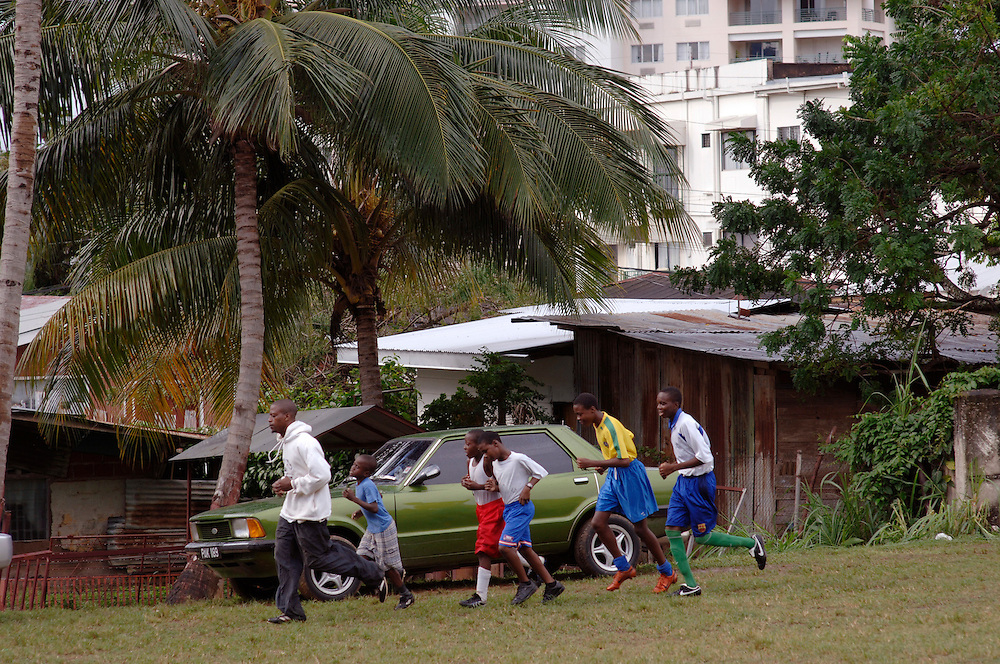 Trinidad & Tobago, Port of Spain, football, soccer, World Cup; The National Football Team, the Soca Warriors, of this tiny nation of 1.3 qualified for the 2006 World Cup in Germany. In Cocorite, a suburb of Trinidad's capital Port of Spain, every child kicks the ball during free time. Rodney Dopwell, 28, just founded a small team  of young boys and practices with them at the local football field. .German: Trinidad & Tobago, Port of Spain, Karibik, Fussball, Fussballspieler, Fussballweltmeisterschaft, WM, Die National Mannschaft von T&T, die 'Soca Warriors', hat sich als kleinste Nation fuer die Teilnahme an der WM 2006 qualifiziert. In Cocorite, einem Vorort der Haupstadt Port of Spain, kickt jedes Kind.  Rodney Dopwell, 28, hat gerade eine kleine Jugendmannschft gegruendet. Trainiert wird auf dem lokalen Boltzplatz.