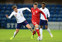 England U21's Kieran Dowell (left) and Denmark U21's Anders Dreyer battle for the ball during the international friendly match at the Blue Water Arena, Esbjerg.