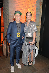 MARC QUINN and OTTILIE WINDSOR at A Night of Motown in aid of Save The Children UK held at The Roundhouse, Chalk Farm Road, London on 3rd March 2016.