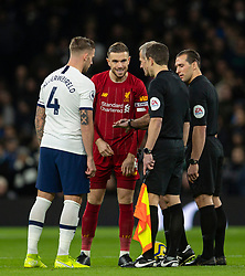 LONDON, ENGLAND - Saturday, January 11, 2020: Liverpool's captain Jordan Henderson (C) and Tottenham Hotspur's captain Toby Alderweireld (L) during the pre-match coin toss before the FA Premier League match between Tottenham Hotspur FC and Liverpool FC at the Tottenham Hotspur Stadium. (Pic by David Rawcliffe/Propaganda)