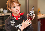 Lynne Tolley holds a bottle of Jack Daniel's Whiskey No 7 during a cooking and whiskey tasting event with Jack Daniel's great-grandniece, Lynne Tolley held at the Cookook in Zurich, Switzerland, Thursday, Sept. 30, 2010. (Photo by Patrick B. Kraemer / MAGICPBK)