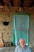 old sick man sitting on his verandah, Dobrogea region
