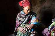 Bhafta Fisha, 20 and her 3 weeks old baby girl Kalayt Brhanu at home, Adi Sibhat, Tigray, Ethiopia
