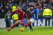 Niall McGinn (#10) of Aberdeen FC runs round Daniel Candeias (#21) of Rangers FC during the Ladbrokes Scottish Premiership match between Rangers and Aberdeen at Ibrox, Glasgow, Scotland on 5 December 2018.