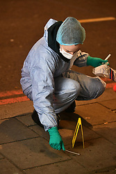 © Licensed to London News Pictures. 01/01/2019. London, UK. Police Forensics on Park Lane after a man was found stabbed in a flat early on New Year's Day. Detectives have launched a murder investigation following his death. Two other men - aged 37 and 29 - and a 29-year-old woman were also found with stab injuries. They were treated at the scene before being taken to hospital; their injuries are not life threatening. Photo credit: Ben Cawthra/LNP