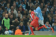 Manchester City midfielder Yaya Toure battles with Sevilla  defender Benoit Tremoulinas during the Champions League Group D match between Manchester City and Sevilla at the Etihad Stadium, Manchester, England on 21 October 2015. Photo by Alan Franklin.