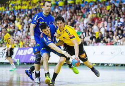 Ivan Sliskovic of Celje PL vs Jernej Papez of Gorenje during handball match between RK Gorenje Velenje and RK Celje Pivovarna Lasko in Final match of 1st NLB League - Slovenian Championship 2013/14 on May 23, 2014 in Rdeca dvorana, Velenje, Slovenia. Photo by Vid Ponikvar / Sportida