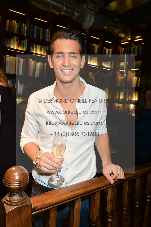 OLLIE LOCKE at a party to celebrate the engagement of Natalie Coyle and Zafar Rushdie held at Library, St.Martin's Lane, London on 6th September 2014.