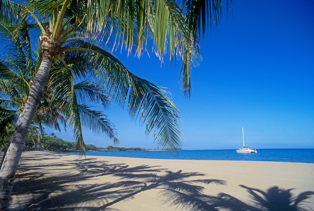 Anaeho'omalu Bay and beach with sailing catamaran; Waikoloa Beach Resort, Kohala Coast, Island of Hawaii.