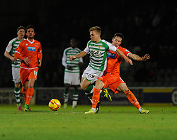 Yeovil Town's Sam Hoskins is challenged by Blackpool's Kirk Broadfoot - Photo mandatory by-line: Dougie Allward/JMP - Tel: Mobile: 07966 386802 03/12/2013 - SPORT - Football - Yeovil - Huish Park - Yeovil Town v Blackpool - Sky Bet Championship