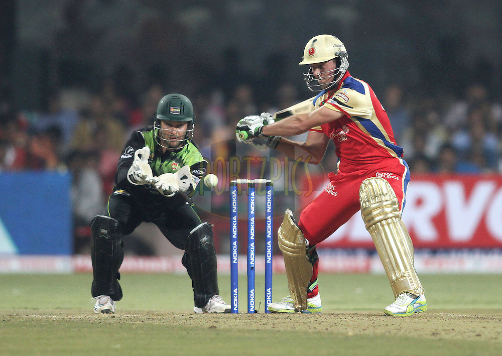 AB de Villiers of Royal Challengers Bangalore looks to attack a delivery during match 1 of the NOKIA Champions League T20 ( CLT20 )between the Royal Challengers Bangalore and the Warriors held at the  M.Chinnaswamy Stadium in Bangalore , Karnataka, India on the 23rd September 2011..Photo by Shaun Roy/BCCI/SPORTZPICS