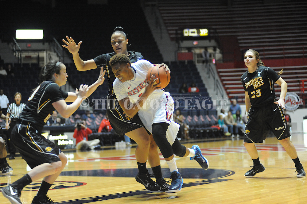 "Ole Miss Lady Rebels forward Tia Faleru (32) vs. Southern Mississippi Lady Golden Eagles forward Tamara Jones (4) at the C.M. ""Tad"" Smith Coliseum in Oxford, Miss. on Thursday, December 18, 2014. (AP Photo/Oxford Eagle, Bruce Newman)"