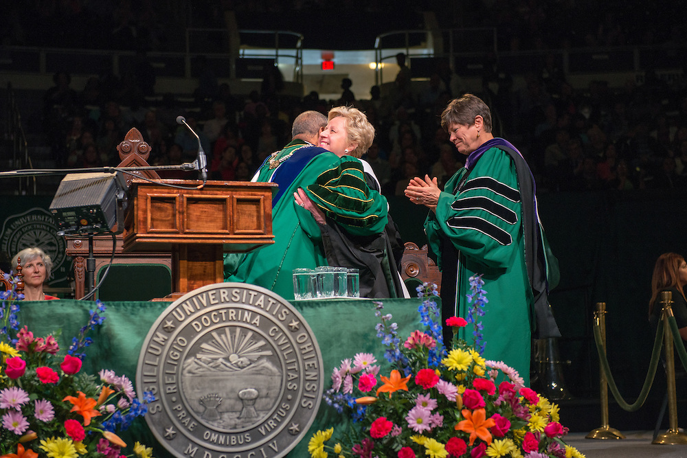 OHIO alum Cheryl Hurley (Center) , President & Chief Executive Officer of the Library of America recieves an honorary degree at graduate commencement. Photo by Ben Siegel
