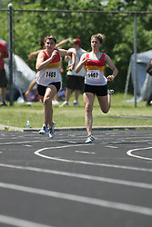 Hamilton, Ontario ---06/06/08--- Natalie Buttinger of Resurrection in Kitchener competes in the 4X100 meter relay at the 2008 OFSAA Track and Field meet in Hamilton, Ontario..SEAN BURGES