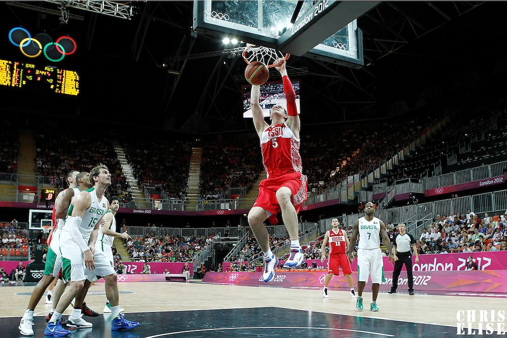 02 August 2012: Russia Timofey Mozgov dunks the ball during 75-74 Team Russia victory over Team Brazil, during the men's basketball preliminary, at the Basketball Arena, in London, Great Britain.