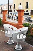 face to face lovers bench in  spanish colonial style in a valladolid garden yucatan mexico