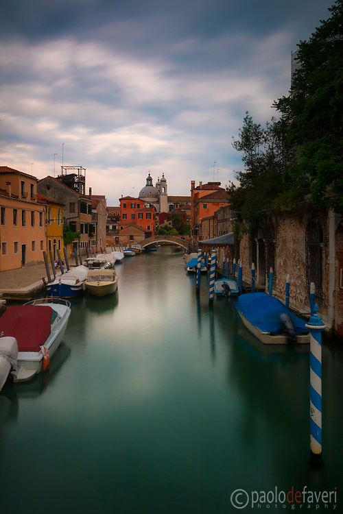 An early morning view of the Canal San Trovaso in the Sestiere (district) of Dorsoduro in Venice, with the church of La Salute in the background.