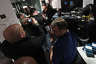 MANCHESTER, ENGLAND, NOVEMBER 11, 2009: Randy Couture (center top) is surrounded by reporters at the open work-outs for UFC 105 at the Crowne Plaza Hotel in Manchester, England on November 11, 2009.