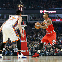 12 March 2012: Chicago Bulls point guard Derrick Rose (1) looks to pass the ball during the Chicago Bulls 104-99 victory over the New York Knicks at the United Center, Chicago, Illinois, USA.