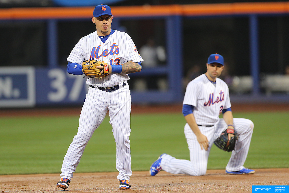NEW YORK, NEW YORK - July 09: Asdrubal Cabrera #13 of the New York Mets and Neil Walker #20 of the New York Mets during the Washington Nationals Vs New York Mets regular season MLB game at Citi Field on July 09, 2016 in New York City. (Photo by Tim Clayton/Corbis via Getty Images)