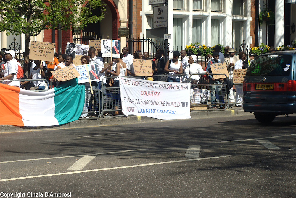 Protesters against  the French and UN presence in  Ivory Coast. They are holding banners demanding that they would leave the Ivory Coast.
