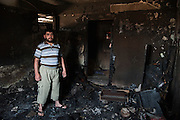 Sunni apartment burned by RPG fire from the Alawite Jabal Mohsen district, on the frontline just inside the Sunni neighborhood Bab al-Tebbaneh, Tripoli, Lebanon..Appartement sunnite brulé par tirs RPG venant du quartier alaouite Jabal Mohsen,  sur la ligne de front dans le quartier sunnite Bab al-Tebbaneh, Tripoli, Liban