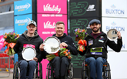 David Weir, winner of the men's wheelchair race (centre), Johnboy Smith who finished in third place (right) and Simon Lawson who finished in second place during the Vitality Big Half in London.