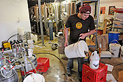 Drew Huerter, head brewer at the Mattingly Brewing Co., sanitizes his brewing equipment.
