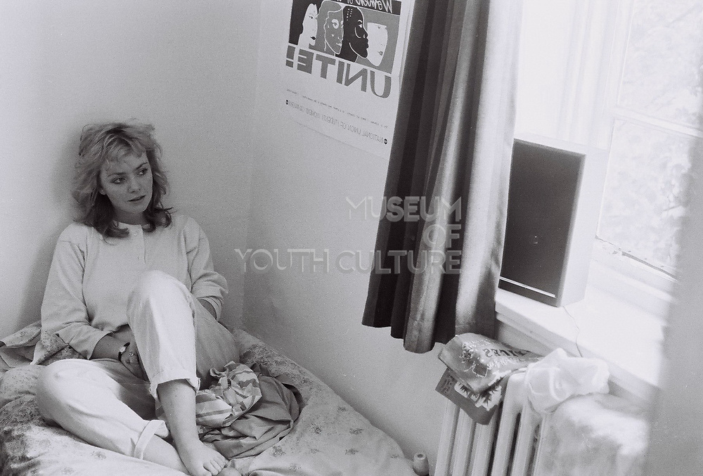 Girl sitting on bed, Norwich, UK, 1985