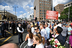 © Licensed to London News Pictures. 03/06/2018. London, UK.  Families of the victims and dignitaries make their way to a minutes silence for the victims of the 2017 London Bridge terror attack at London Bridge. Eight people were killed and 48 were injured when a van was deliberately driven into pedestrians on London Bridge. Three occupants then ran to the nearby Borough Market area carrying knives and fake explosives. Photo credit: Ben Cawthra/LNP