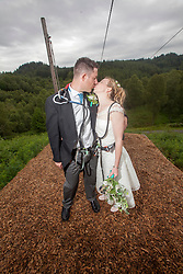Martin Milner and Colette Gregory tying the knot in the trees at Go Ape Aberfoyle, after the last zip wire.