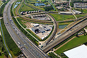 Nederland, Zuid-Holland, Barendrecht, 23-05-2011; A15 met rond de Eerste  Barendrechtste weg bedrijventerrein voor overslag en distributie en kantoorpark met kantoorvilla's. Het gebied wordt omsloten door spoten van Betuweroute, HSL en reguliere spoorwegen..Motorway A15 with industrial estate for warehousing and distribution and office park with office villas. The area is enclosed by Betuweroue (freight railway)  HSL high-speed train and regular railways..luchtfoto (toeslag), aerial photo (additional fee required).copyright foto/photo Siebe Swart