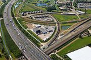 Nederland, Zuid-Holland, Barendrecht, 23-05-2011; A15 met rond de Eerste  Barendrechtste weg bedrijventerrein voor overslag en distributie en kantoorpark met kantoorvilla's. Het gebied wordt omsloten door spoten van Betuweroute, HSL en reguliere spoorwegen..Motorway A15 with industrial estate for warehousing and distribution and office park with office villas. The area is enclosed by Betuweroue (freight railway)  HSL high-speed train and regular railways..luchtfoto (toeslag), aerial photo (additional fee required).copyright foto/photo Siebe Swart