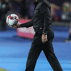 06 July 2019, Egypt, Cairo: Egypt's national team coach Javier Aguirre holds a ball on the touchline during the 2019 Africa Cup of Nations round of 16 soccer match between Egypt and South Africa at Cairo International Stadium. Photo : PictureAlliance / Icon Sport