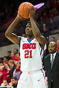 DALLAS, TX - DECEMBER 29: Ben Emelogu #21 of the SMU Mustangs brings the ball up court against the Midwestern State Mustangs on December 29, 2014 at Moody Coliseum in Dallas, Texas.  (Photo by Cooper Neill/Getty Images) *** Local Caption *** Ben Emelogu