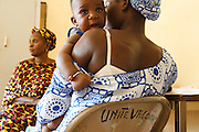 A child rests on his mother's shoulder after being vaccinated at the Kita reference health center in the town of Kita, Mali on Monday August 30, 2010.